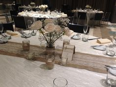 Burlap and lace give a rustic elegant feel to the reception and add candles for some soft lighting. Floral centerpieces made by Flower in VIeques