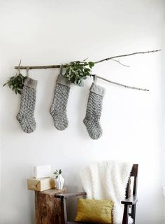small space decor white wall with gray christmas stockings