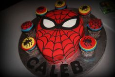 thinking about doing a spiderman head cake surrounded by batman and superman cupcakes for Gray's 4th birthday party