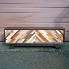 Low media console made from small pieces of reclaimed wood - complete with sliding doors #reclaimed