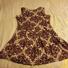 NWOT Tan and purple Charming Charlie dress Tan and purple patterned Charming Charlie dress with small pleats in the front and zipper back. Hits about mid-thigh for length. Never worn! Make me an offer! Charming Charlie Dresses