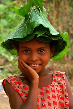 Asia - Philippines / Luzzon Aeta girl  Cool, a rain proof hat/umbrella.