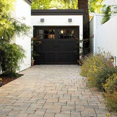 "Those pavers <3 ""Durable concrete pavers set in a regular pattern are a good match for the architectural style of the house, and their subtly varied colors help mediate the starkness of a black-and-white color scheme."" (Sunset Magazine via SFGate)"
