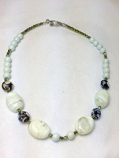This beautiful white glass beads necklace are made with the combination of glass beads, white glass pearls and Czech crystal made this necklace a unique piece. Measure: 17 inches