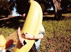 This is a gif of Dan Smith from Bastille hugging a giant banana. you're welcome. :)