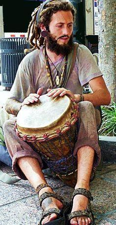 solo street hand drummer.. http://worldhanddrums.com