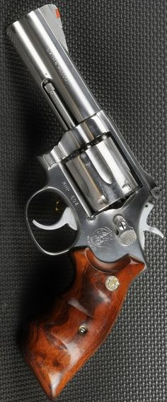 Smith & Wesson mdl 686 Stainless classic with Smith Wesson Combat grips! Please visit our store for Smith Wesson grips! http://stores.ebay.com/gce-sports