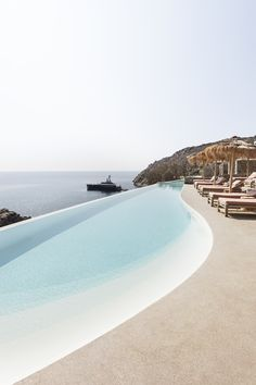 [Photography by Yiorgos Kordakis] Crystal cerulean waters and stone encrusted cliffsides form a mirage-like setting for The Wild Hotel. The retreat, which launched earlier this year, is one of two new additions to the Interni group's design-led portfolio of hospitality developments #tropicalresort #dreamydestination #destinationholiday #holidayinspiration #dreampool