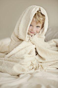 precious portrait of child wrapped in chenille