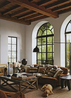 The styling of this location is great because the use of wood is shown on the ceiling, the windows, the ottoman, the tables and the couches are colors of brown and beige. It has a summer home or cabin type of feel.