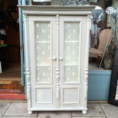Vive la France! The completed French style hand-painted armoire cupboard in Annie Sloan Paris Grey and Old White chalk paint