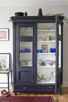 A 19th-century Dutch cabinet from Phoenix (http://phoenixongolborne.co.uk) houses the couple's wedding china – a mix of Royal Doulton and Limoges porcelain. For a similar finish, try Annie Sloan's Chalk Paint in Charcoal (http://anniesloan.com)