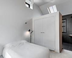 Large wardrobe serves as a room divider between the attic bedroom and bathroom. home decor and interior decorating ideas. Box Bedroom, Condo Bedroom, Bedroom Closet Design, Small Bedroom Designs, Master Bedroom Closet, Closet Designs, Wardrobe Design, Wardrobe Wall, Bedroom Wardrobe
