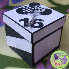 BLACK & WHITE EXPLOSION BOX FOR HIM Originally designed and sold by Ruby Crafts and Gifts Shop #rubycrafts #rubycraftsandgiftsshop #giftshop #blackandwhiteexplosionbox #explosionboxforhim #personalizedexplosionbox #masculineexplosionbox #16thbirthday #surprisebox #waterfallcard #explosionboxforhim #explosionbox #explodingbox #favorideas #giftideas #personalizedgift #token #souvenir Birthday Explosion Box, Exploding Gift Box, Waterfall Cards, Surprise Box, 16th Birthday, Favors, Decorative Boxes, Black And White, Shop