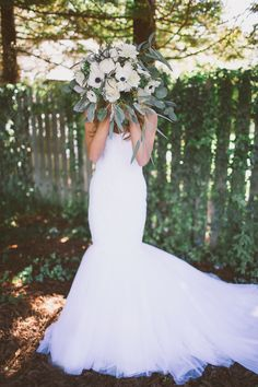 sweet bridal portrait :) photo by Kelsea Holder http://ruffledblog.com/cambria-pines-lodge-wedding #fitnflare #weddingdress #bride