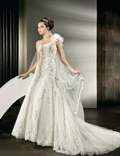 All over lace, One shoulder, Fit 'n' Flare with pleated Tulle on neckline and flowers on one shoulder.
