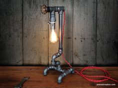 Edison Light  - Plumbing Pipe - Steampunk Art - Industrial Furniture - Faucet Handle. $195.00, via Etsy.
