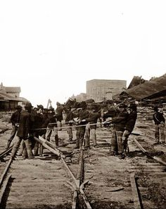 "Atlanta, Georgia… Sherman's Men Tearing Up Railroad Track. Photographed in 1864 by Barnard, George N. Sherman's 62,000 men marched out of Atlanta ""into the fat fields of Georgia like locusts devouring the land"", Sherman tore up every mile of railroad track and almost every station."