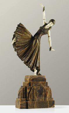 "** Demetre H. Chiparus (Romanian, 1886-1947) ""TESTRIS"", A COLD-PAINTED, PARCEL-GILT BRONZE AND CARVED IVORY FIGURE ON ONYX BASE, CIRCA 1925."