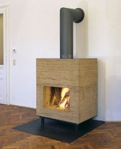 Rammed-earth wood-burning stove
