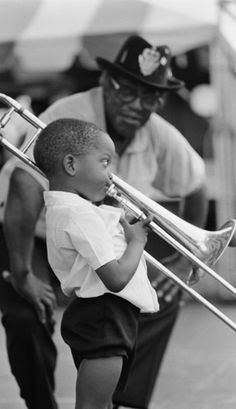 Bo Diddley presents Troy Michael Andrews (Trombone Shorty) at the New Orleans Jazz & Heritage Festival in 1990 • photo: Michael P. Smith on npr Music