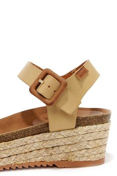 """For downtown strolls or weekend excursions, the MTNG 52319 Vache Camel Espadrille Wedge Sandals are the ideal choice! A smooth faux leather upper includes a wide toe band and ankle strap with adjustable buckle for a custom fit. Contoured faux suede-lined insole greets composite cork, 2.25"""" espadrille-wrapped wedge, and 1"""" toe platform. Rubber nonskid sawtooth sole. Available in European sizes, 36-41. Measurements are for a size 36. All man made materials."""