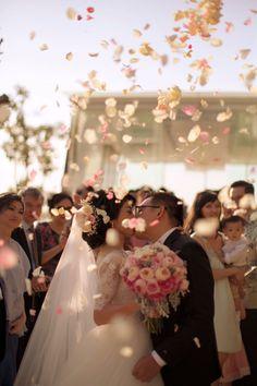 Wedding kiss under then warm sun