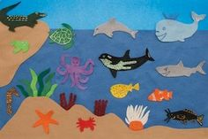 Felt sea animals small world, great way for little ones to begin exploring the creatures of the ocean through play. I love using small world play as an interactive and organic way to teach kids about ecosystems, just by playing my characters true to nature, asking questions, and listening for all that the kiddos already understand so I know how to help them fill in the gaps in their knowledge.