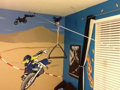 Build an indoor zip-line. What you need: (1) cable, (2) 100 lb. eye hooks, (1) cable tensioner, (2) cable clamps, (1) old wakeboard handle, (1) trolley, and most importantly... EAGER KIDS!!! This project cost about $20 at the hardware store (minus the wakeboard handle) and took about 30 minutes to get set up.