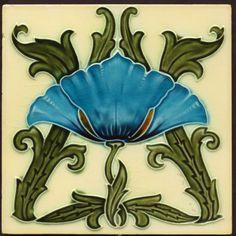 Minton Majolica tile, cream background, blue flower, olive stems.