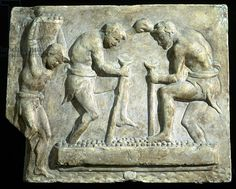 Relief depicting two men pressing grapes and a young man carrying a basket (1st cent.) Museo della Civilta Romana, Rome, Italy