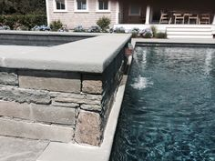 Pool with raised spa and copper spillway. Stone veneer.  Nantucket.
