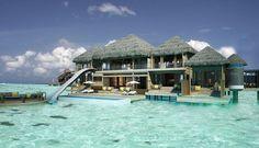 Beach house, The Maldives Islands- love the slide!