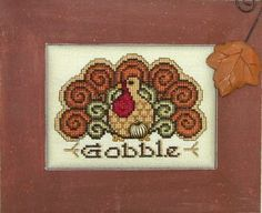 Charmed Gobble is the title of this cross stitch pattern from Hinzeit and price includes the pattern one charm.