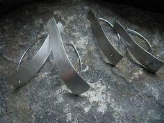 Korviksia. Uniikkeja. Yksilöllisiä. Hopeaa. Matta vai röpöpinta? . . . #korvikset #korvakorut #uniikkikorut #hopeakorut #suomalaistakäsityötä  #earrings #uniquejewelry #silverjewelry #handmadeinfinland #finnishdesign #designer #jewelrysmith #koruseppä #anuek #anuekdesign #kerava Pocket, Earrings, Ear Rings, Stud Earrings, Ear Piercings, Ear Jewelry, Beaded Earrings Native, Pierced Earrings, Bag