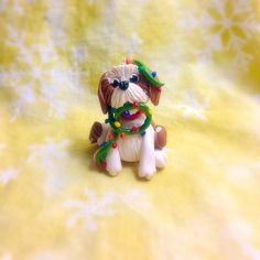 Custom handmade Shihtzu shih tzu dog Christmas ornament. Made from Sculpey Premo polymer clay. To inquire about have a custom ornament made of your pet please contact me on Facebook - Tempies Menagerie #dog #dogs #doglover #pet #pets #petlover #groomer  #inspiredbypets  #crafter #craft #diy #etsy #custom #handmade #polymerclay #sculpey #premo #christmas #ornament #ooak