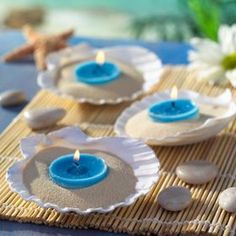 Wedding Decorations very sweet and simple - Check out photos of gorgeous and unique beach theme wedding centerpieces. Get inspiration from amazing beach wedding centerpieces perfect for any budget. Seashell Centerpieces, Simple Wedding Centerpieces, Beach Wedding Decorations, Seashell Candles, Seashells, Sand Candles, Blue Candles, Centerpiece Ideas, Beach Theme Centerpieces