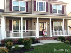 tan house with green shutters and white trim | This picture is from the day we closed. The girls let themselves in ...