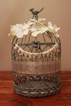 Bird cage card holder. So much better than a regular card box. This one has flowers, pearls, and glittery ribbon. I love that is sparkles! It EVEN has a Cards banner made of burlap, lace, and pearls. So unique! Would work for wedding, baby shower, or bridal shower. Can even use it as home decor after the event! Birdcage.