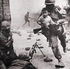 Vietnam War - A soldier rescuing Vietnamese children. Because there were many atrocities during the Vietnam War, it's nice to see pictures like this.