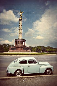 Vintage light blue Volvo parked outside the Berlin Victory Column in Berlin, Germany. © John Bragg Photography