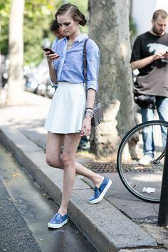 Model at Couture Fall 2014 // Breezy button up, white A-line skirt and slip-on sneakers