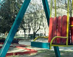 Blue red and yellow wooden chair swing ~ Oldtime childhood memories