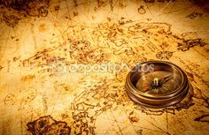 Vintage compass lies on an ancient world map. — Foto de Stock