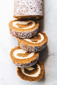 This pumpkin roll recipe is a moist, spiced pumpkin cake rolled with a silky cream cheese filling that is sure to impress your holiday guests.