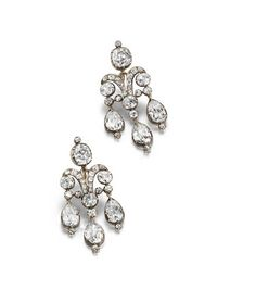 A pair of early century girandole earrings. Each collet-set cushion-shaped diamond surmount suspending a scrolling old brilliant-cut diamond plaque, terminating in three pear-shaped diamond drops, mounted in silver and gold, cased by Bulgari Roma. Antique Earrings, Antique Jewelry, Vintage Jewelry, Diamond Studs, Diamond Jewelry, Diamond Earrings, Gemstone Earrings, Titanic Jewelry, Pear Shaped Diamond