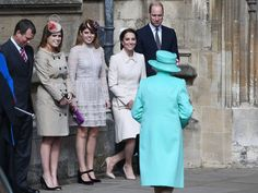 PHOTO: Catherine, The Duchess of Cambridge (2-R) performs a curtsy as The Queen, Elizabeth II (front) arrives for the Easter Service at St. Georges Chapel in Windsor, England, April 16, 2017.