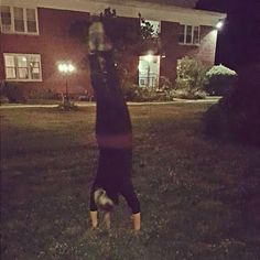 Doing handstand in the yard » Yoga Pose Weekly