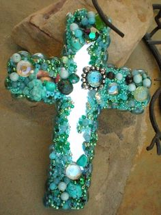 Beautiful Cross made by using broken jewelry, beads, and small stones.