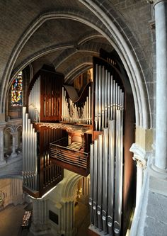 C.B. Fisk pipe organ, opus 120, Switzerland.  I've seen consoles situated just below pipes, but this one is literally surrounded by them!